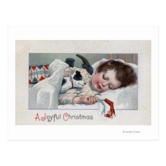 Un ChristmasBoy alegre que duerme con el perrito Tarjetas Postales