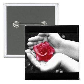 Un color de rosa en la mano 2 pin
