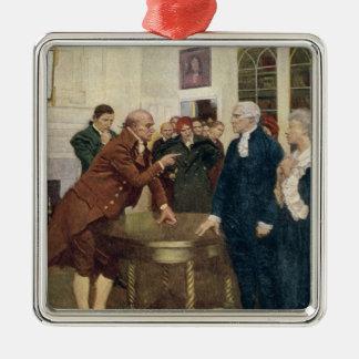 Un comité de los patriotas que entregan un adorno navideño cuadrado de metal