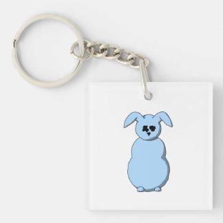 Un conejo de la nieve, dibujo animado en azul clar llavero cuadrado acrílico a una cara