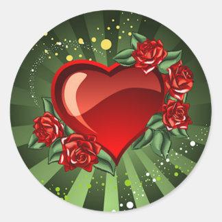 Un corazón y rosas pegatinas redondas