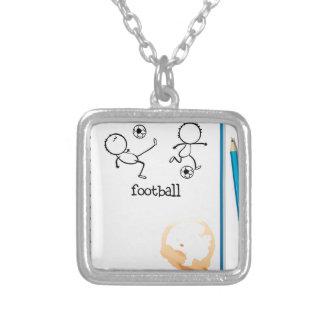Un cuaderno con un diseño del fútbol colgante cuadrado