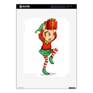Un duende con un regalo sobre su cabeza iPad 3 pegatina skin