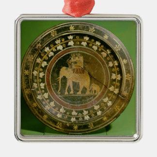 Un elefante usado en guerra contra adorno navideño cuadrado de metal