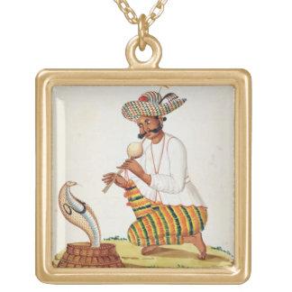 Un encantador de serpiente indio con una cobra, de pendiente personalizado