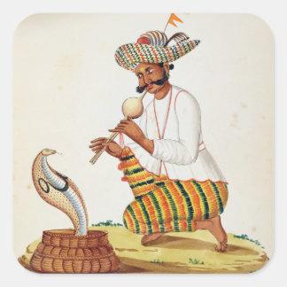 Un encantador de serpiente indio con una cobra, de pegatina cuadrada