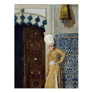 Un eunuco antes de la puerta del harem postal