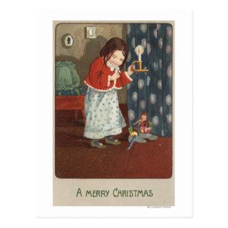 Un feliz ChristmasGirl que sostiene una palmatoria Tarjetas Postales
