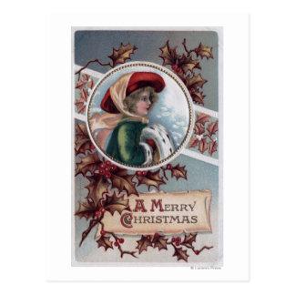 Un feliz ChristmasKid en ropa del invierno Postal