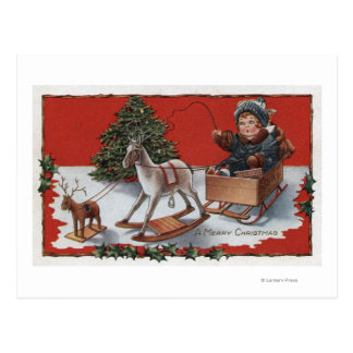 Un feliz ChristmasKid en un trineo del Jabón-Box Postal