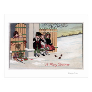 Un feliz ChristmasKids por la cerca Postal
