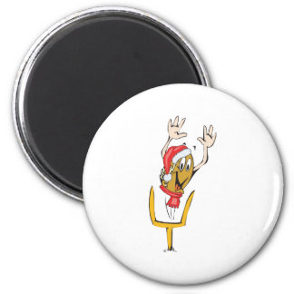 Un fútbol del navidad que lleva un gorra del navid imanes para frigoríficos