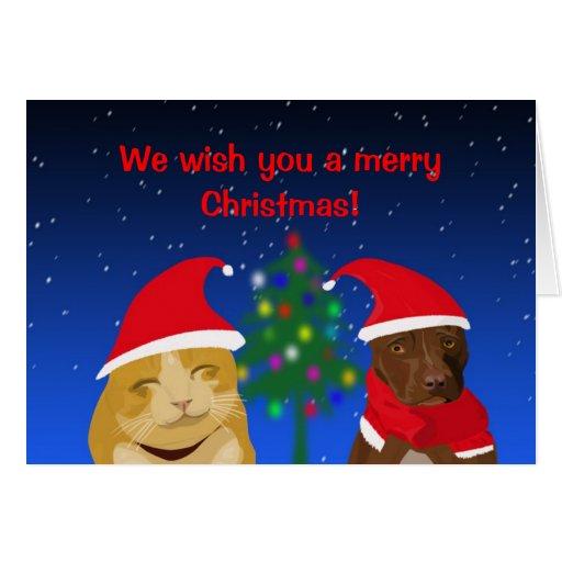 Un gato y un perro, saludo de Navidad con un árbol Tarjetón