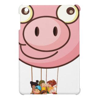 Un globo del cerdo que lleva una cesta con los