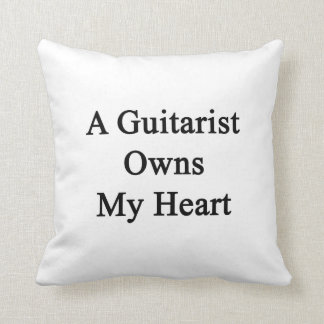 Un guitarrista posee mi corazón cojines