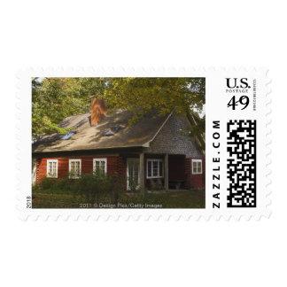 Un hogar rojo del registro sello