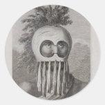 Un hombre de las islas de bocadillo en una máscara pegatina redonda