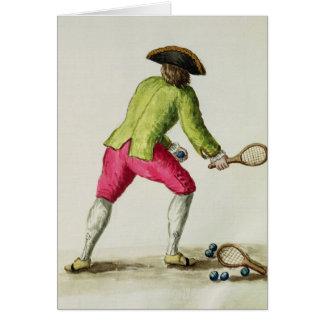 Un hombre que juega con una estafa y las bolas tarjeton