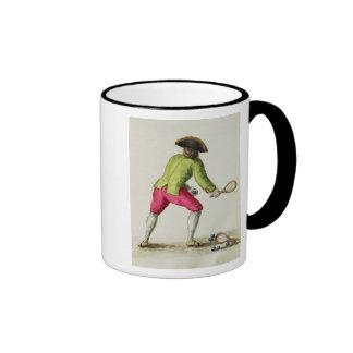 Un hombre que juega con una estafa y las bolas taza de café