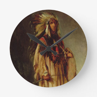Un indio norteamericano en un paisaje extenso, reloj