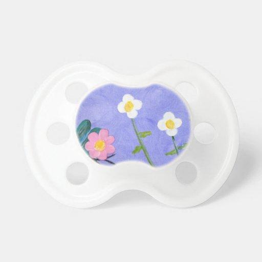 Un jardín de flores chupetes para bebes