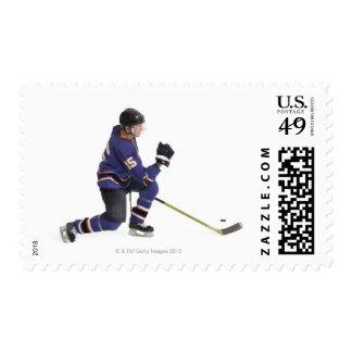 un jugador de hockey masculino caucásico adulto en timbres postales
