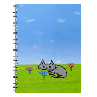 Un Katty cansado se encrespa para arriba por algun Cuaderno