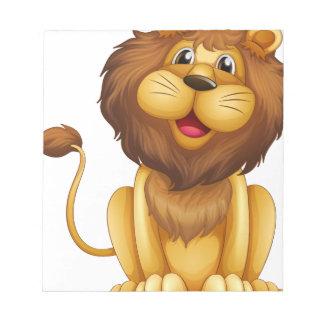 Un león feliz en una posición sentada bloc de papel