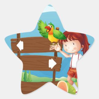 Un loro y un chica al lado de un letrero en la pegatina en forma de estrella
