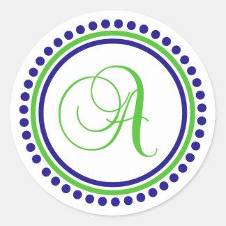 Un monograma (círculo del punto del azul marino/de etiqueta redonda