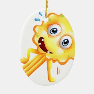 Un monstruo amarillo que hace el ejercicio del adorno ovalado de cerámica