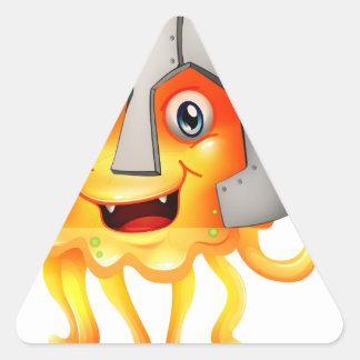 Un monstruo con una espada y un casco pegatina triangular