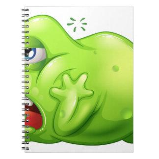 Un monstruo del greenslime en el aburrimiento libros de apuntes