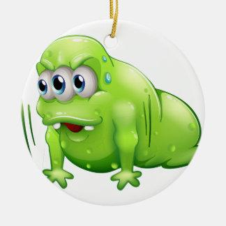 Un monstruo del greenslime que hace el ejercicio adorno redondo de cerámica