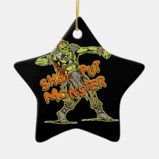 un monstruo lanzamiento de peso adorno navideño de cerámica en forma de estrella