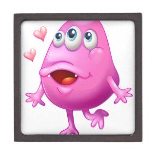 Un monstruo rosado con dos corazones caja de regalo de calidad