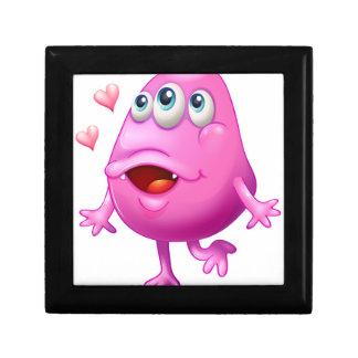 Un monstruo rosado con dos corazones caja de regalo cuadrada pequeña
