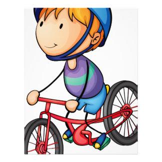 un montar a caballo del muchacho en una bicicleta plantilla de membrete