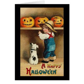 Un muchacho y un perro del feliz Halloween Felicitación