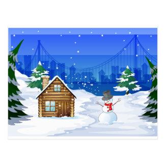 Un muñeco de nieve cerca de la casa de bambú tarjetas postales