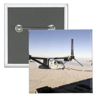 Un MV-22 Osprey reaprovisiona el midflight de Pin Cuadrado