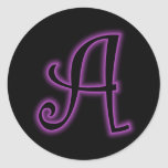 Un neón de la púrpura del monograma etiqueta redonda
