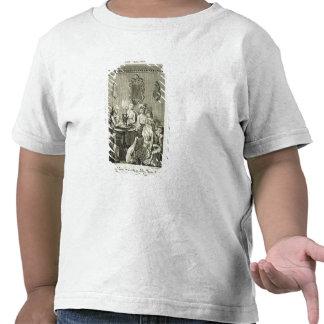 Un padre que lee a su familia por la luz de una camisetas