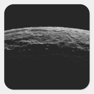 Un paisaje irreal de la luna de Saturn Pegatina Cuadrada