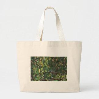 un pájaro en el arbusto bolsas