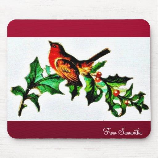 Un pájaro en la rama de árbol de navidad que mira  tapetes de raton
