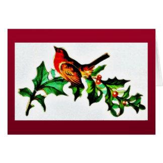 Un pájaro en la rama de árbol de navidad que mira  tarjetón