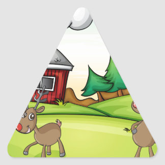 un Papá Noel y un reno Pegatina Triangular