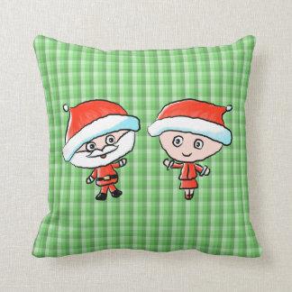 Un par feliz en el navidad Sr y señora Claus Cojines