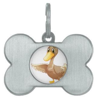 Un pato marrón placa mascota